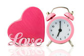 Pink alarm clock and  heart shape gift box — Stock Photo