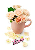 Beige roses in a cup  — Stock Photo