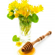 Honey with wooden dipper and flowers — Stock Photo #71757657