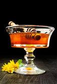 Honey in glass dish — Stock Photo