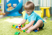 Child boy playing with block toys indoor — Stock Photo