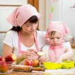 Mother and daughter making apple pie together — Stock Photo