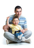 Happy little boy and his dad playing with a playstation together — Stock Photo