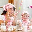 Mother and kid have fun preparing cookies at kitchen — Stockfoto