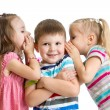 Kids girls sharing a secret with child boy isolated — Stock Photo #53794647