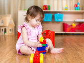 Child girl playing with block toys indoor — Stock Photo