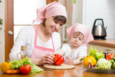 Mother and kid daughter cooking in the kitchen  — Stock Photo
