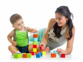Little boy and mother playing together with construction set toy — Stock Photo