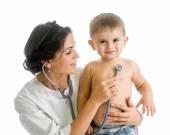 Doctor examining child boy isolated on white — Stock Photo