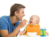 Smiling baby eating food — Stock Photo
