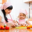 Mom and kid preparing healthy food — Stock Photo