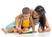 Kid boy and his mom play with toy — Stock Photo