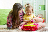 Happy mother and kid play at home — Stock Photo