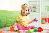 Funny little child playing with toys — Stock Photo