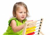 Kid playing with abacus — Stock Photo