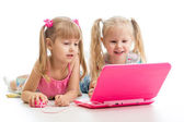 Kids friends looking at the laptop — Stock Photo