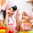 Mom and kid preparing healthy food — Stock Photo #54587863