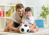 Kid boy and father playing with soccerball  indoor — Stock Photo