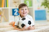 Kid boy with soccerball  indoor — Stock Photo