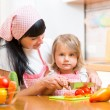 Mom and kid girl preparing healthy food — Stock Photo #55307651