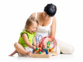 Kid girl and mother playing with color educational toy — Stock Photo