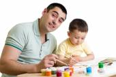 Kid boy and dad paint together isolated on white — Stock Photo