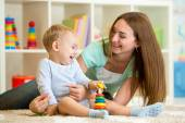Cute mother and kid boy play together indoor at home — Stock Photo