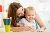 Child boy and mother draw with colorful pencils — Stock Photo