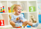 Kid playing with toy animals indoors — Stock Photo