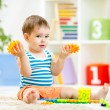 Kid boy playing with block toys at home — Stock Photo #56422687