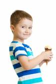 Happy kid boy eating icecream in studio isolated — Stock Photo