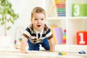 Child boy playing with toys indoor — ストック写真