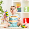 Kid boy playing with block toys indoors — Stock Photo #56518141