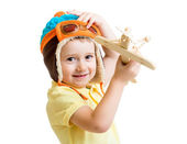 Kid boy playing with wooden airplane toy and dreaming about pilo — Stock Photo