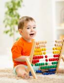 Kid boy playing with abacus — Stock Photo