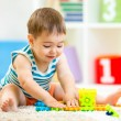Child boy playing with block toys indoor — Stock Photo #56638813