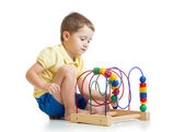 Pretty kid boy plays with color educational toy — Stock Photo
