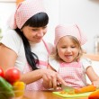 Mom and child preparing healthy food at kitchen — Stock Photo #56686979