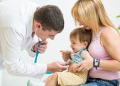 Doctor examining kid patient with stethoscope — Stock Photo