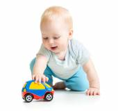 Baby boy toddler playing with toy car — Stock Photo