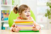 Smart kid girl preschooler with books — Stock Photo