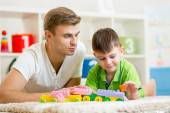 Father with his child son play together — Stock Photo