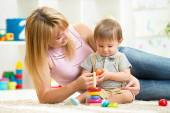 Happy mother and child son play together indoor at home — Foto de Stock