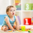 Kid boy playing with block toys indoors — Stock Photo #57597607