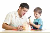 Dad and son kid tinkering nesting box — Stock Photo