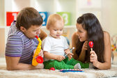 Happy family play musical toys — Stock Photo