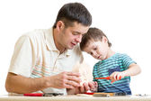 Father and son tinkering together — Stock Photo
