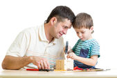 Man and kid child boy tinkering nesting box — Stock Photo