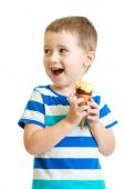 Happy kid boy eating ice-cream in studio isolated — Stock Photo