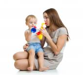 Child and mother play musical toys isolated — Stock Photo
